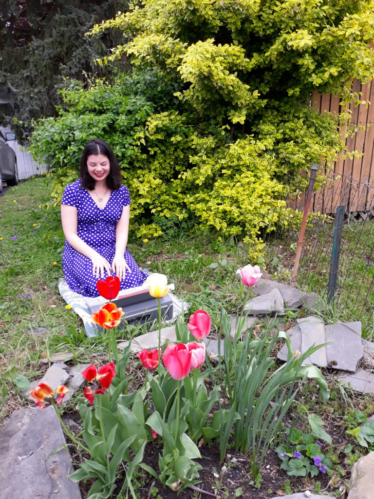 Laurel with typewriter and tulips